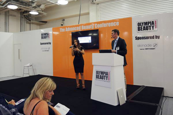 surgeon presenting at the Olympia beauty show 2015